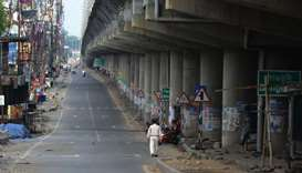 A man walks along a deserted road during a government-imposed nationwide lockdown as a preventive me