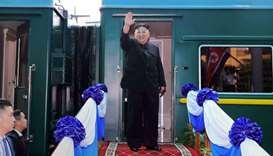 This file photo taken on March 2, 2019 shows North Korea's leader Kim Jong Un waving before boarding
