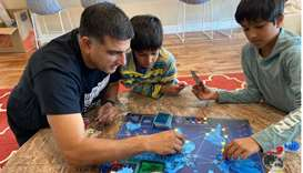NO CHILD'S PLAY: Dr Amit Gohil plays the board game Pandemic with two of his three children, sons Sh