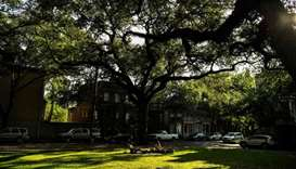 People sit in a garden square in the Historic District in Savannah, Georgia