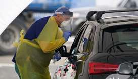 A medical personnel administers tests for the coronavirus disease (COVID-19) at the Bondi Beach driv