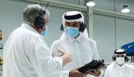 His Highness the Amir Sheikh Tamim bin Hamad al-Thani listening to an explanation about the producti