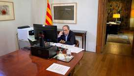 Spain's Catalonia regional head of government Quim Torra talks on his mobile phone during an intervi
