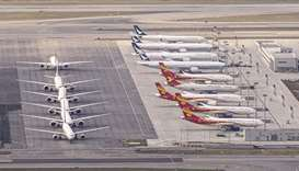 Aircraft operated by Cathay Pacific Airways and Hong Kong Airlines sit parked on the tarmac at Hong