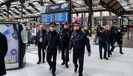 Police prefect Didier Lallement (left) is seen at Paris's Gare de Lyon train station yesterday, on t