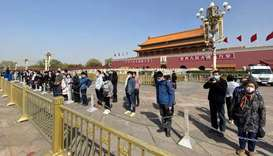 People bow in front of Tiananmen Gate in Beijing during a three minute national memorial to commemor