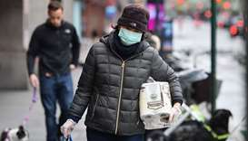 People wear face masks in New York on Friday.