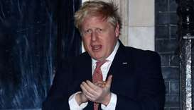Britain's Prime Minister Boris Johnson applauds outside 10 Downing Street during the Clap For Our Ca