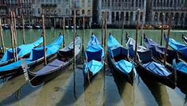 Clear water is seen in Venice's canals due to less tourists, motorboats and pollution, as the spread