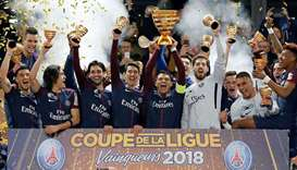 In this March 31, 2018, picture, Paris Saint-Germain players celebrate their record eighth French Le