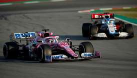 Racing Point's Lance Stroll overtakes Williams' Nicholas Latifi during F1 pre-season testing on Febr