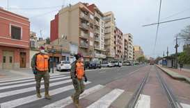 Spanish soldiers patrol the streets of Valencia on April 7, 2020 during a national lockdown to preve