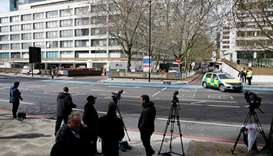 Members of the news media gather outside St Thomas' Hospital in London