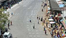 People walk Chennai