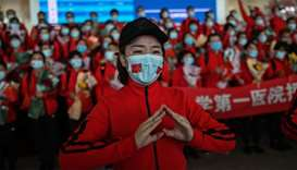 A medical staff member from Jilin Province tears up during a ceremony before leaving as Tianhe Airpo
