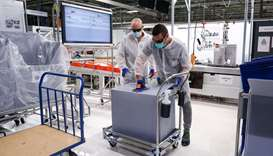 Employees work on the production of medical ventilators at the factory of Spanish automobile manufac