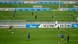FC Schalke players take part in a training session at the club's training ground in Gelsenkirchen, G