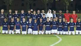 In this file photo, Paris Saint-Germain President Nasser al-Khelaifi poses with academy players and