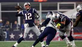 File photo of Tom Brady (left) in action during a playoff game against the Tennessee Titans at Gille