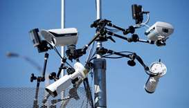 Surveillance cameras are pictured on a security fence near the site of the upcoming G7 leaders' summ