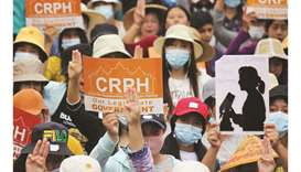 Protesters holding signs relating to the Committee for Representing Pyidaungsu Hluttaw (CRPH) and po