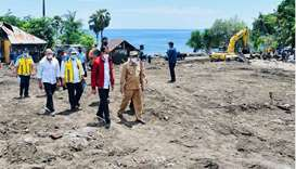 Indonesian President Joko Widodo visits an area affected by flash floods triggered by a tropical cyc