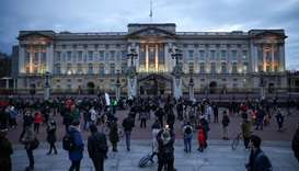 People gather outside Buckingham Palace after Britain's Prince Philip, husband of Queen Elizabeth, d