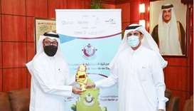 HE Sheikh Dr Khalid bin Thani al-Thani, chairman of Dar Al Sharq, handing over the award to QC's Abd