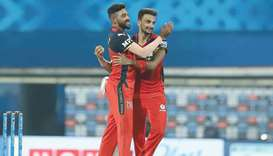 Royal Challengers Bangalore's Harshal Patel (right) celebrates with Mohamed Siraj after taking the w
