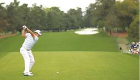 Hideki Matsuyama of Japan plays his shot from the first tee during the third round of the Masters at