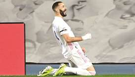 Real Madrid's Karim Benzema celebrates after scoring during the La Liga match against Barcelona at t