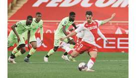 AS Monaco's Wissam Ben Yedder scores a goal from the penalty spot during the Ligue 1 match again