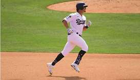 Los Angeles Dodgers left fielder Zach McKinstry rounds the bases after hitting a two run home run ag