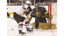 Marc-Andre Fleury of the Vegas Golden Knights makes a save against Dryden Hunt of the Arizona Coyote