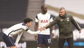 Manchester United's manager Ole Gunnar Solskjaer (right) bumps his fist with Tottenham's striker Son