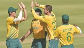 South Africa's George Linde (second from right) celebrates with teammates after the dismissal of Pak