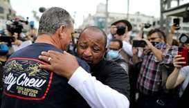 Najee Ali, a Black Lives Matter activist, embraces Peter Zazzara, a former Marine and White Lives Ma