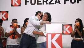 Peru's presidential candidate Keiko Fujimori of the Fuerza Popular party is embraced by her husband