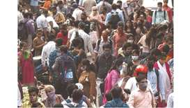 People are seen along a busy road in Mumbai yesterday, as India overtook Brazil as the country with