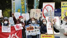 People rally to protest against the Japanese government's decision to discharge contaminated radioac