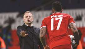 Bayern Munich's German head coach Hans-Dieter Flick (left) gives instructions to defender Jerome Boa