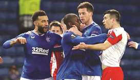 In this file photo taken on March 18, 2021, Rangers' Glen Kamara (centre) and Slavia Prague's Ondrej