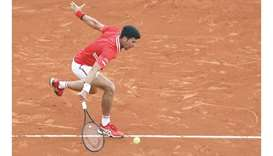 Serbia's Novak Djokovic returns the ball during his second round singles match against Italy's Janni