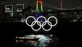 The Rainbow Bridge and Tokyo Tower are illuminated with Olympic colours to mark 100 days countdown t