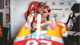 Repsol Honda Team's Spanish rider Marc Marquez smiles in the team garage during the first MotoGP fre