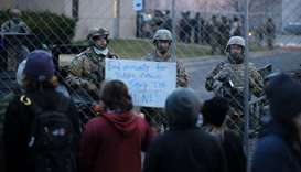 National guard soldiers monitor a protest outside of the Brooklyn Center police station in Brooklyn