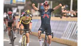 Ineos Grenadiers' British Thomas Pidcock of Great Britain celebrates as he crosses the finish line d