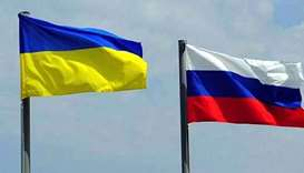 Flags of  Ukraine and Russia  AFP