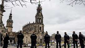 Police officers secure an area in front of the Cathedral in the city center in Dresden, eastern Germ