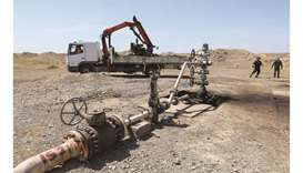 A damaged oil well which, according to oil ministry, was attacked by militants, is seen northwest of